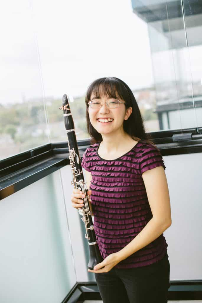 Photograph of Anna holding a clarinet