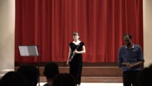 A photo from the premiere of Hikinuki: Richard Bullen on the right and Anna on stage