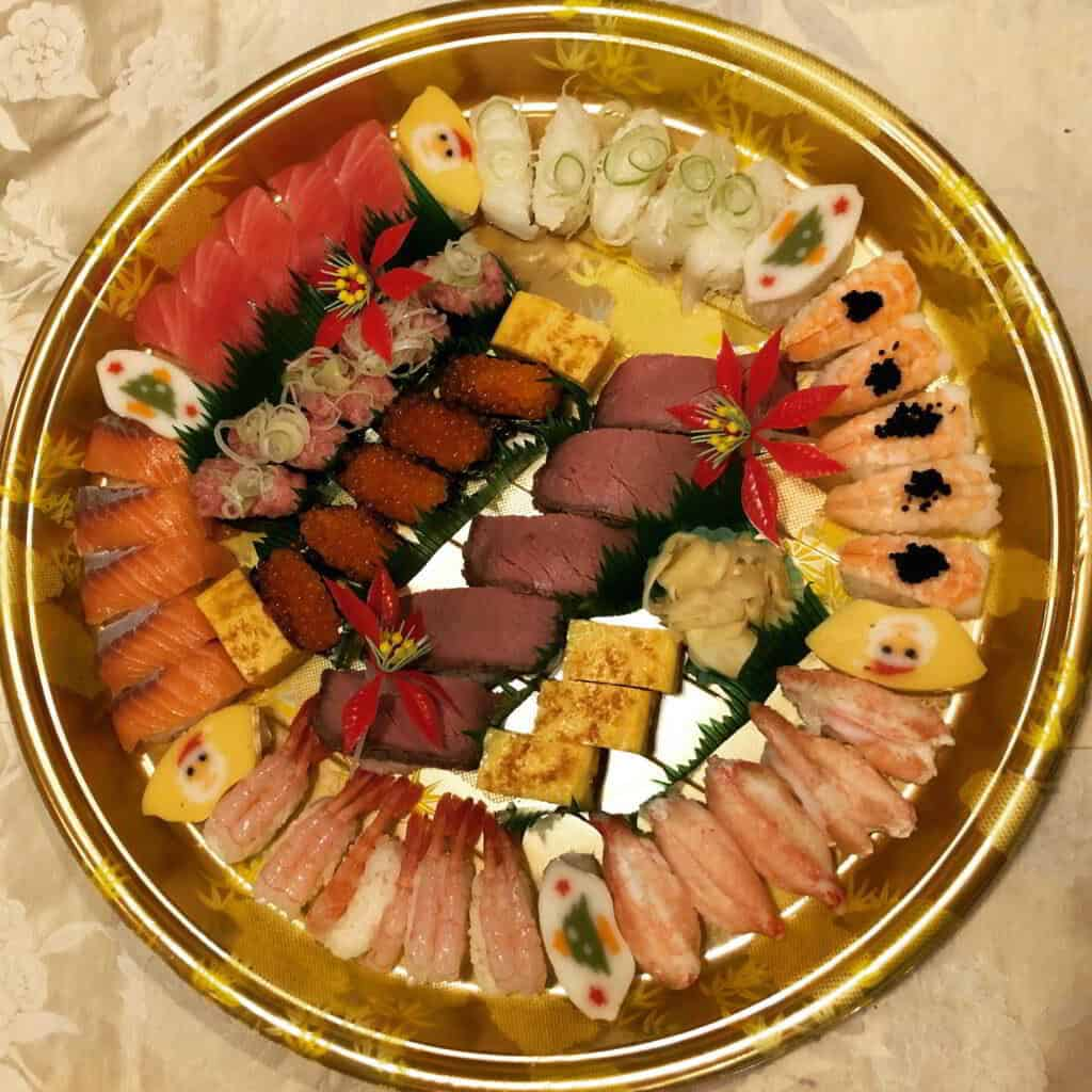 A photograph of a plate of Christmas sushi